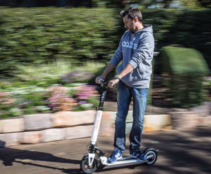Electric Kick Scooter Hire Brisbane - Young Man on Inokim Scooter