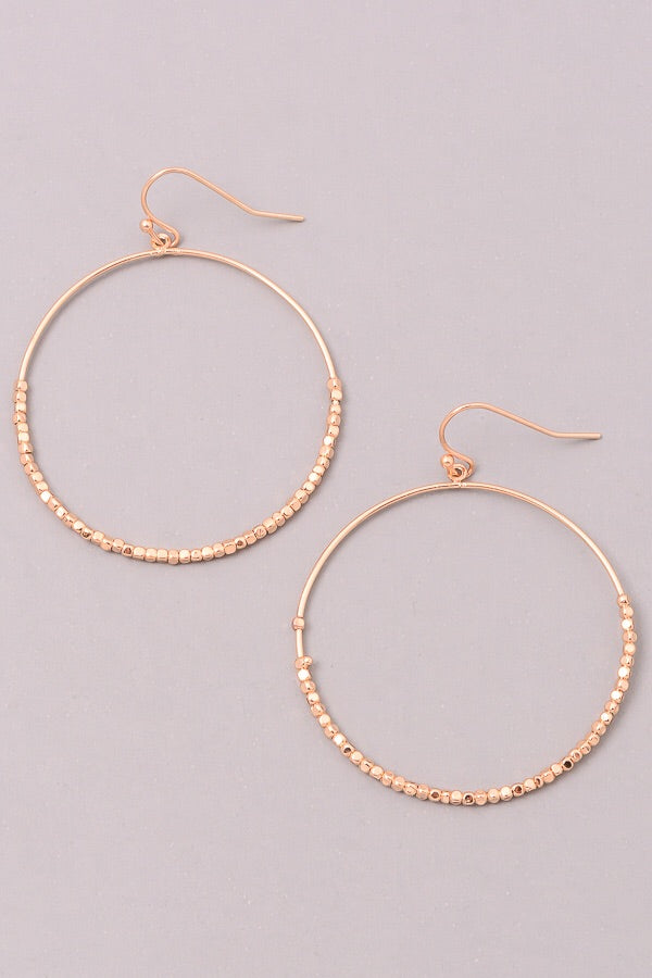 Metallic beaded dangle hoop earrings