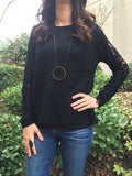 Black sweater with crochet arm detail & tulip style button up back