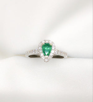 18kt white gold diamond and emerald pear engagement ring