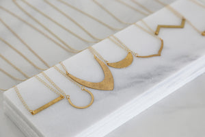 geometric minimal gold necklace