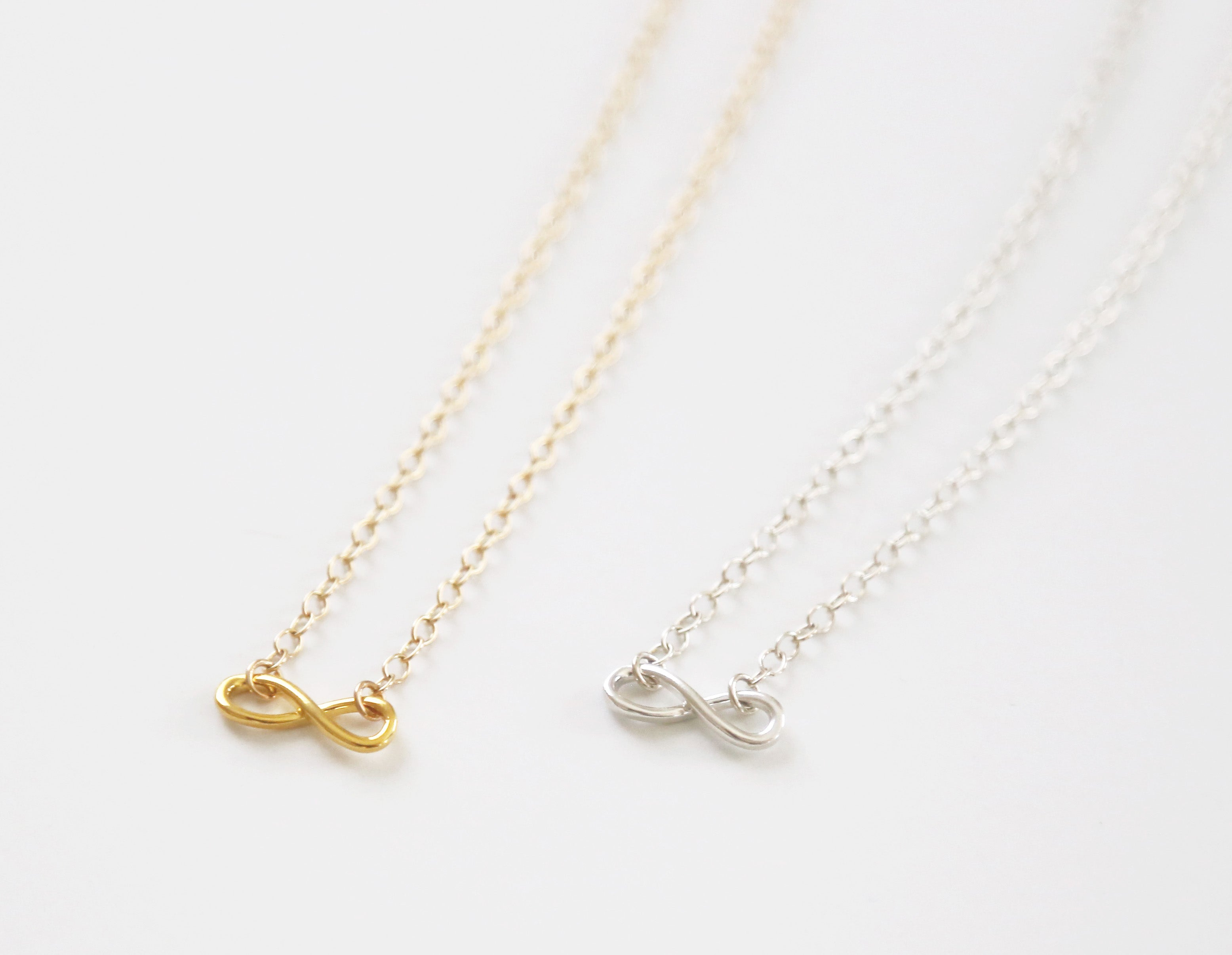 silver are bond infinity between sterling footnotes strongest necklaces categories t sisters invisible ties necklace pendants the jewelry and