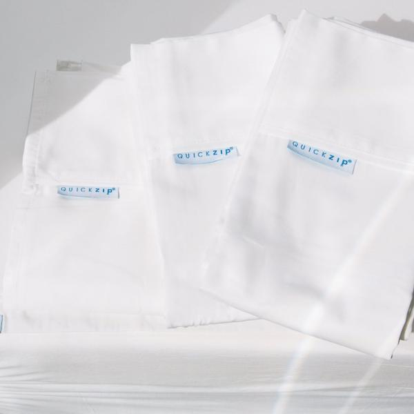 Includes 1 CalKing Flat Sheet + 2 King Pillowcases. White. Luxe Collection flat sheet and pillowcases are 400 thread count, sateen, 100% cotton. The flat sheet is generously cut with an elegant fold over, and pillowcases are Euro style with envelope flap closure (20 x 39).