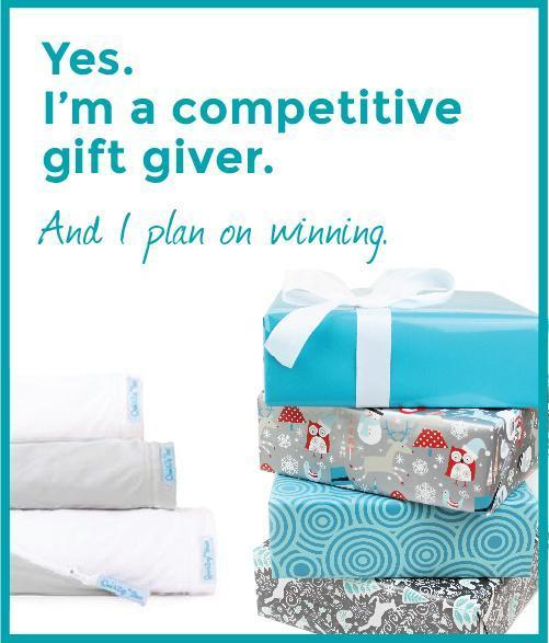 A set of giftwrapped QuickZIp Sheets in teal colored wrapping paper.