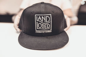 Landlocked Logo Snapback Hat