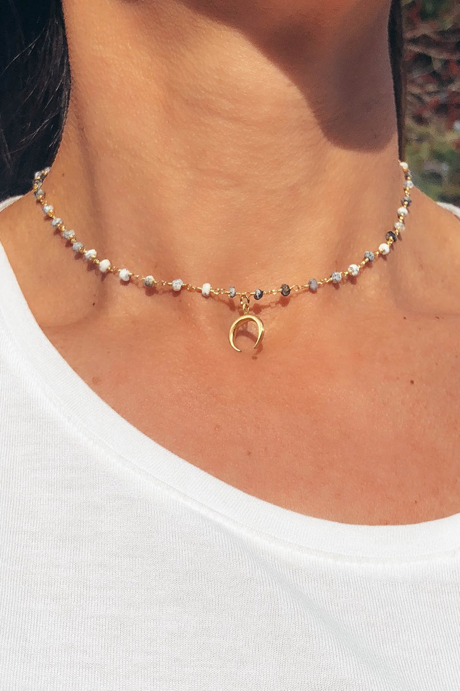 obsidian beaded choker with a gold crescent moon attached