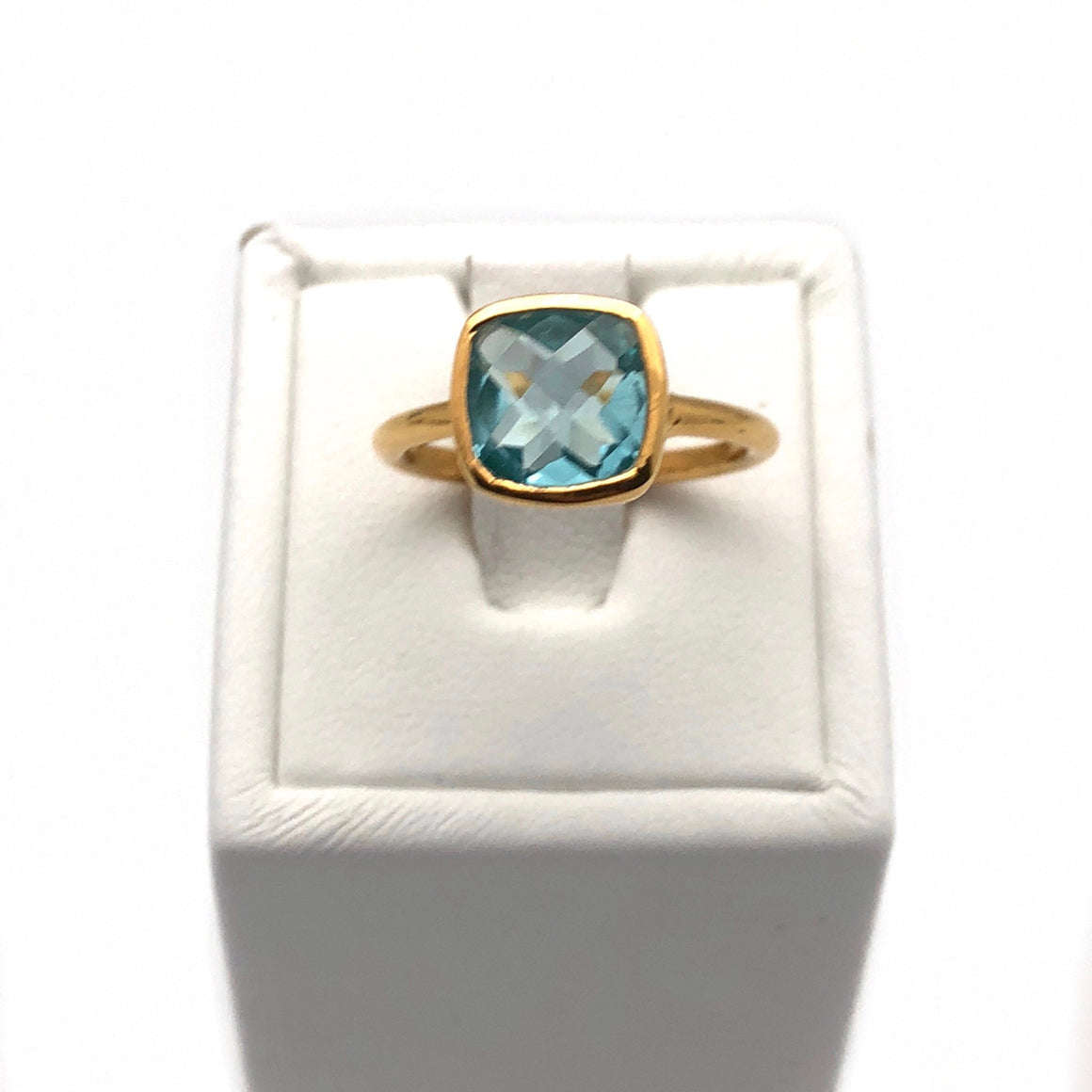 gold ring with blue topaz gem
