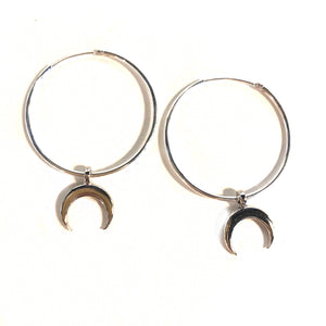 silver hoop earrings with crescent moon charms