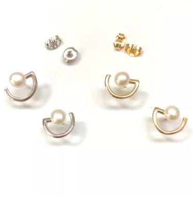 pearl stud earrings in silver and gold