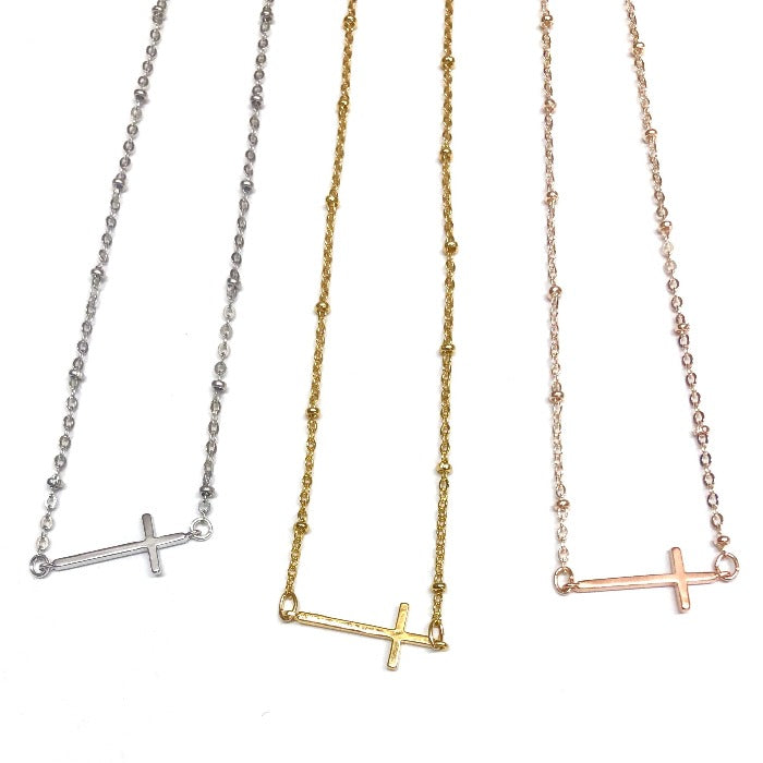 silver, gold, and rose gold cross choker necklace