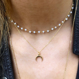 mini pearl choker with golden crescent necklace