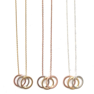 small rose gold, gold, and silver circle necklace