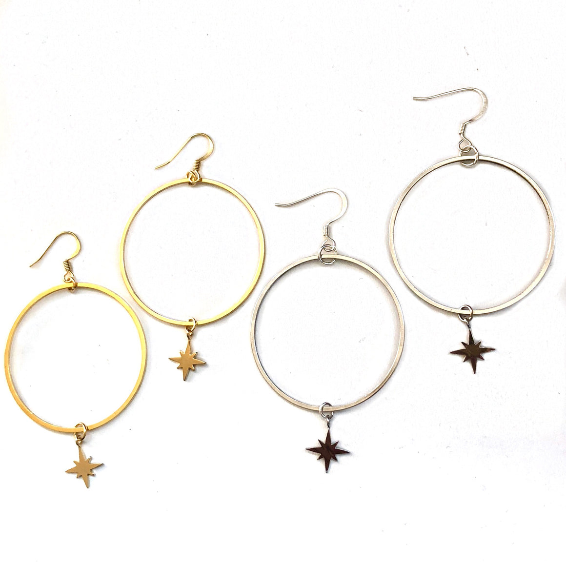 classic hoop earrings with star charm hanging