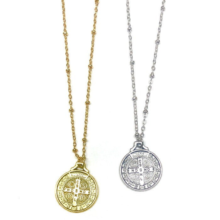 religious coin necklace in gold and silver