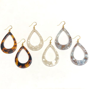 teardrop shaped tortoiseshell earrings in brown, white, and blue