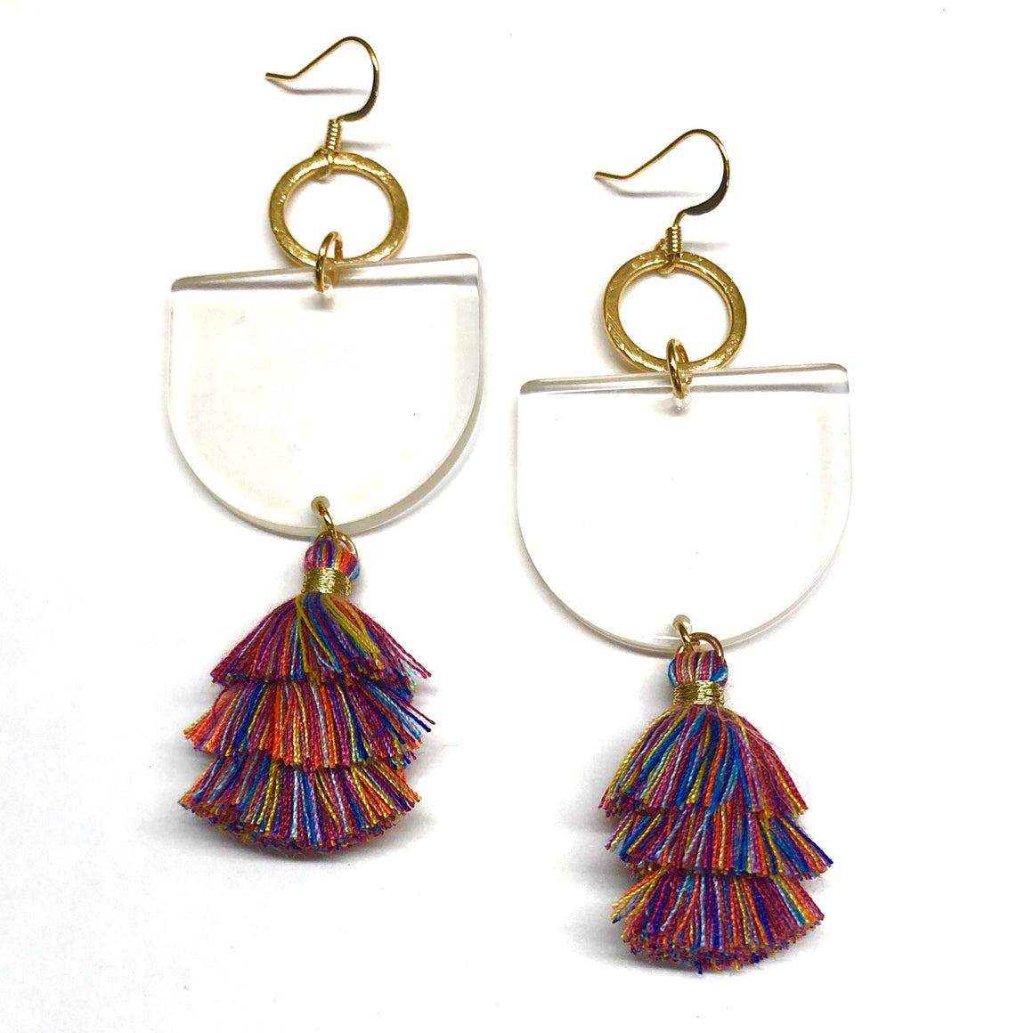 multi colored tassels on a clear acrylic shape with golden hoop