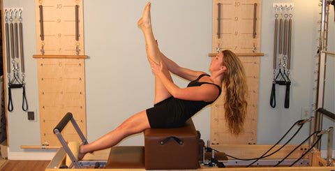 Pilates reformer training on the box