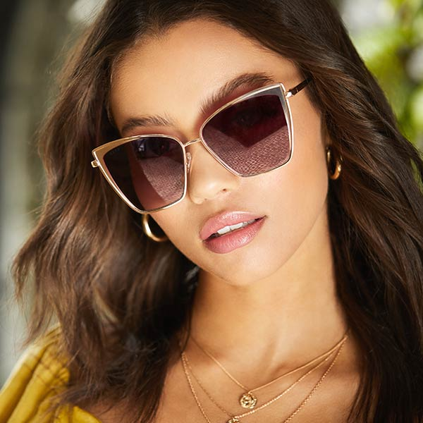 woman wearing brown square shaped sunglasses
