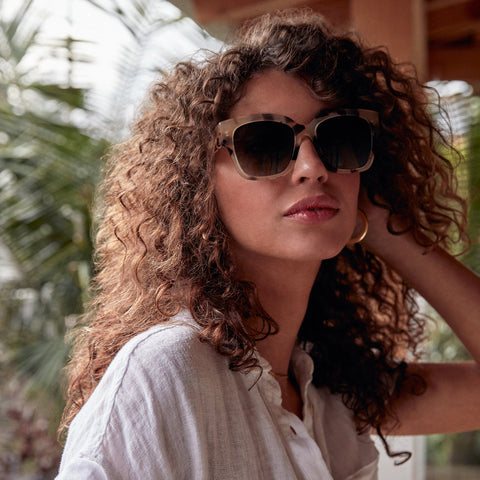 Bella 2 sunglasses in cream tortoise frames with grey gradient lens on a female model
