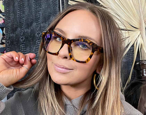 Influencer Lauren Kawano posing with the Hayden glasses in tortoise