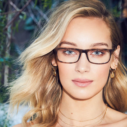 Reese eyeglasses with amber tortoise frames with blue light technology on a female model