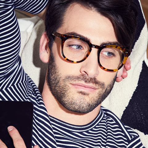 Weston eyeglasses with amber tortoise frames and prescription lens on a male model