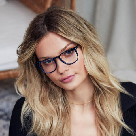 Maxwell eyeglasses in regal blue tortoise frames with prescription lens on a female model