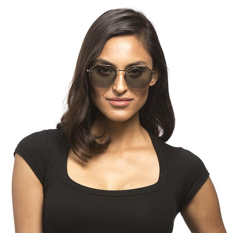 Nova sunglasses with champagne frames and champagne lens on a female model