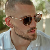 Male model wearing the camden in whiskey and grey polarized