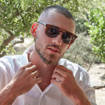 male model wearing the tanner in whiskey and grey polarized