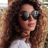 Lenox sunglasses with gold frames and G15 polarized lens on model