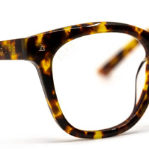 Ryder prescription glasses with amber tortoise frames and clear lens detail view