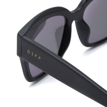 Bella II glasses with matte black frames and lavender flash lens detailed shot