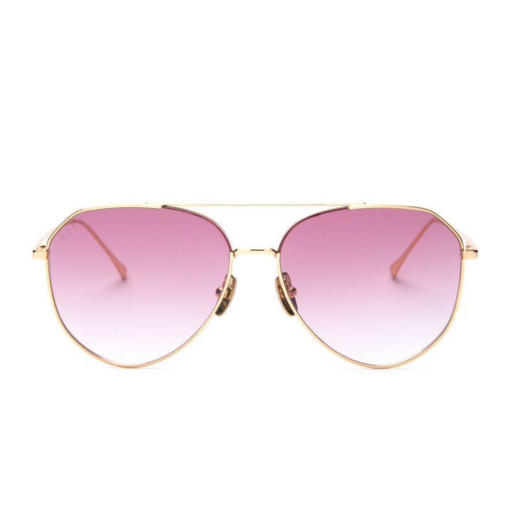 DASH sunglasses with gold frames and rose gradient lens front view