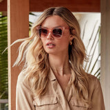 KAIA sunglasses with light pink crystal frames and brown gradient lens on model