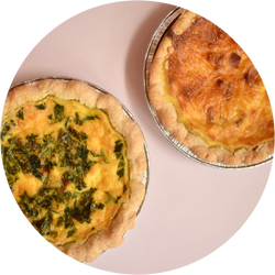 two small quiches on a pink background
