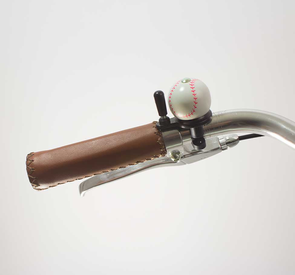 49N BASEBALL BICYCLE BELL ON A HANDLEBAR