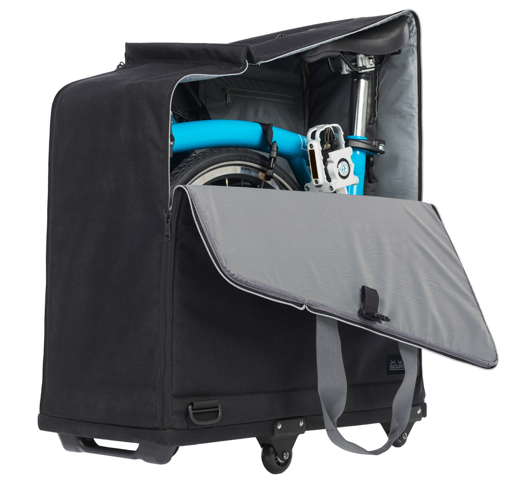 Brompton Padded Travel Bag with 4 Rollers Shown Open with a Bike