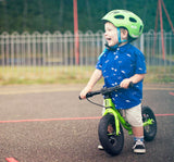 Child riding Frog Tadpole Mini Balance Bike in Green