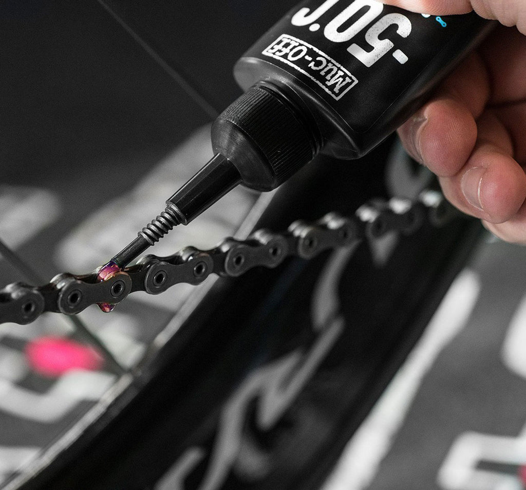 Muc-Off -50 Degree Winter Lubricant Being Applied to Bike Chain