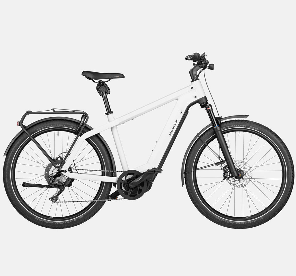 Riese & Muller Charger3 GT Touring E-Bike with Schwalbe Super Moto-X Tires and Thudbuster Seatpost in Ceramic White