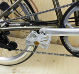 Ti Parts Workshop Double X Pedals in Silver Shown On a Brompton