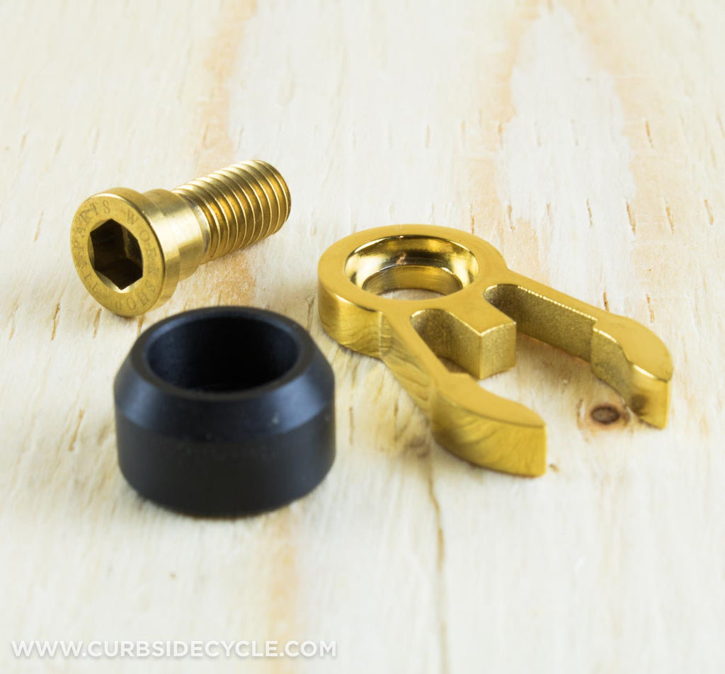 TPW ALUMINUM HANDLEBARCATCH WITH TITANIUM BOLT IN GOLD