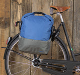 Racktime Liva Roll Top with Clip Colour Block Pannier Blue and Grey Displayed Hooked on Rear Rack of City Bike