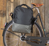 Racktime Liva Roll Top With Clip Colour Block Pannier Bike Bag Black and Grey Displayed Clipped On Bicycle Rack