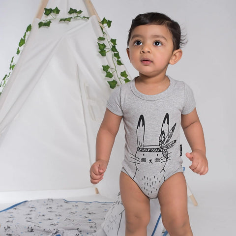 Little boy wearing the Grey Aster & Oak Organic Cotton Bunny Chief Onesie