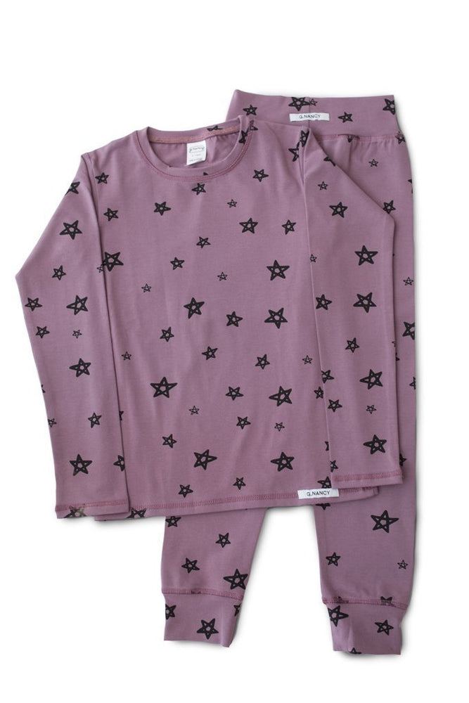 Flat lay of g.nancy organic cotton long sleeve pajama set in jelly colour