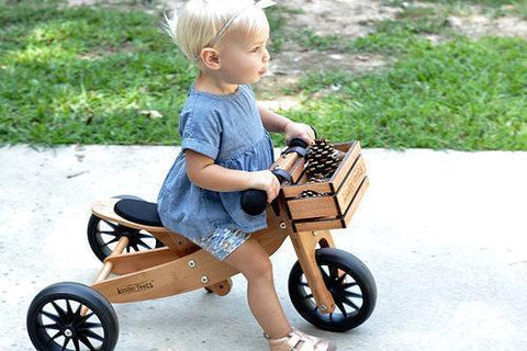 Little girl riding her Kinderfeets Tiny Tots 2-in-1 Tricycle/Balance Bike in Bamboo