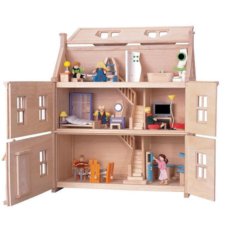 Plan Toys Victorian Wooden Dollhouse shown with furniture inside of it and all panels open for easy play