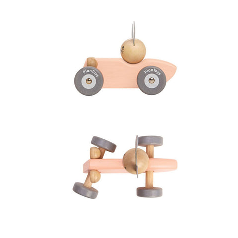 Plan Toys Wooden Racing Car in Pastel Pink with Bunny Driving, showing side and top angle